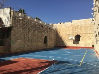 Old City wall next to basketball court