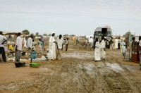 Muddy main street in IDP camp Darfur